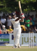 Mahela Jayawardene of Sri Lanka hits a six during day one of the 1st Test Match between Sri Lanka and England at the Galle International Stadium on...