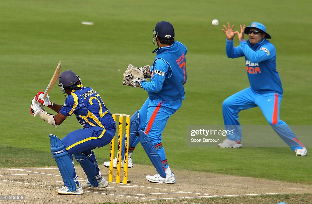 <a gi-track='captionPersonalityLinkClicked' href=/galleries/search?phrase=Mahela+Jayawardene&family=editorial&specificpeople=213707 ng-click='$event.stopPropagation()'>Mahela Jayawardene</a> (L) of Sri Lanka is caught out by <a gi-track='captionPersonalityLinkClicked' href=/galleries/search?phrase=Virender+Sehwag&family=editorial&specificpeople=176591 ng-click='$event.stopPropagation()'>Virender Sehwag</a> (R) of India at slip during the One Day International match between India and Sri Lanka at Bellerive Oval on February 28, 2012 in Hobart, Australia.