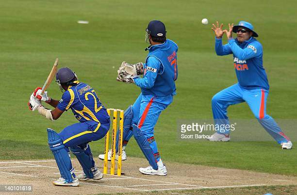 Mahela Jayawardene of Sri Lanka is caught out by Virender Sehwag of India at slip during the One Day International match between India and Sri Lanka...