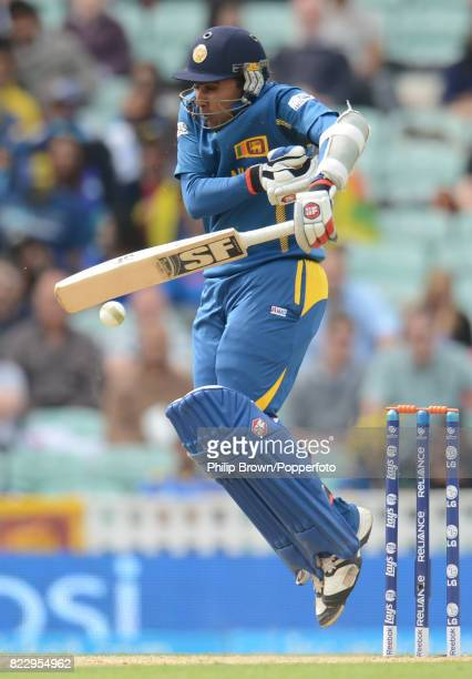 Mahela Jayawardene of Sri Lanka is hit by a shortpitched delivery during his innings of 84 not out in the ICC Champions Trophy group match between...