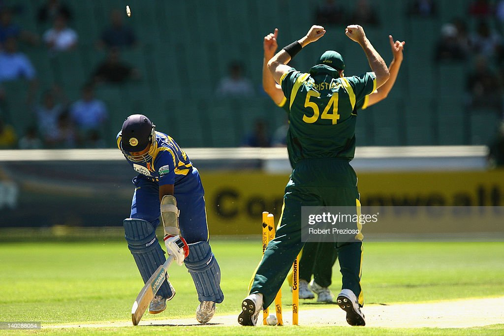 <a gi-track='captionPersonalityLinkClicked' href=/galleries/search?phrase=Mahela+Jayawardene&family=editorial&specificpeople=213707 ng-click='$event.stopPropagation()'>Mahela Jayawardene</a> of Sri Lanka is run out by a direct hit from David Hussey of Australia during the One Day International match between Australia and Sri Lanka at Melbourne Cricket Ground on March 2, 2012 in Melbourne, Australia.