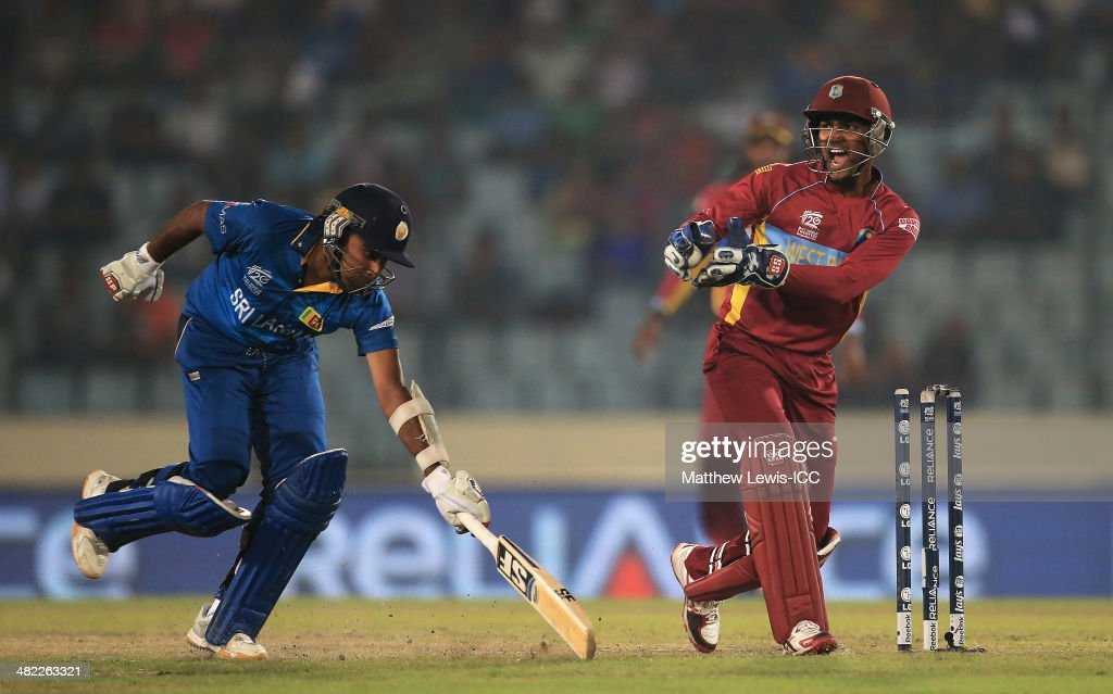 Mahela Jayawardene of Sri Lanka is run out by Darren Sammy of the West Indies, as Denesh Ramdin celebrates during the ICC World Twenty20 Bangladesh 2014 Semi Final match between Sri Lanka and the West Indies at Sher-e-Bangla Mirpur Stadium on April 3, 2014 in Dhaka, Bangladesh.