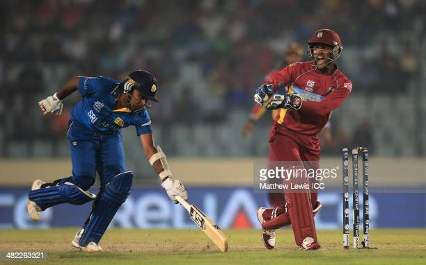 Mahela Jayawardene of Sri Lanka is run out by Darren Sammy of the West Indies as Denesh Ramdin celebrates during the ICC World Twenty20 Bangladesh...