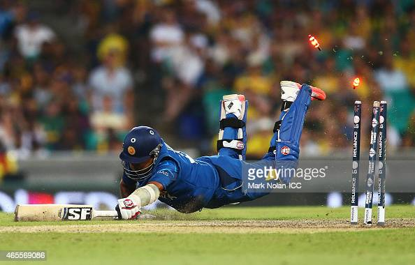 Mahela Jayawardene of Sri Lanka is run out by Michael Clarke of Australia during the 2015 ICC Cricket World Cup match between Australia and Sri Lanka...
