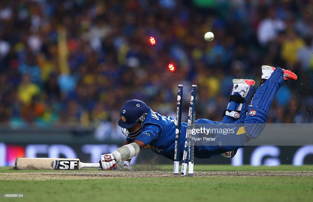 <a gi-track='captionPersonalityLinkClicked' href=/galleries/search?phrase=Mahela+Jayawardene&family=editorial&specificpeople=213707 ng-click='$event.stopPropagation()'>Mahela Jayawardene</a> of Sri Lanka is run out by Michael Clarke of Australia during the 2015 ICC Cricket World Cup match between Australia and Sri Lanka at Sydney Cricket Ground on March 8, 2015 in Sydney, Australia.