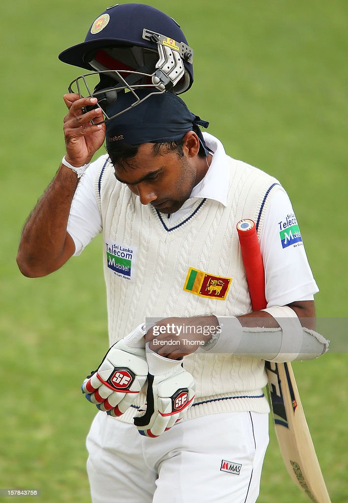 <a gi-track='captionPersonalityLinkClicked' href=/galleries/search?phrase=Mahela+Jayawardene&family=editorial&specificpeople=213707 ng-click='$event.stopPropagation()'>Mahela Jayawardene</a> of Sri Lanka looks dejected as he walks back to the dressing room after being dismissed by Glenn Maxwell of the Chairman's XI during day two of the international tour match between the Chairman's XI and Sri Lanka at Manuka Oval on December 7, 2012 in Canberra, Australia.