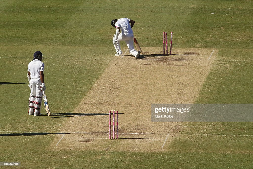 Mahela Jayawardene of Sri Lanka looks on as his dejected partner Angelo Mathews of Sri Lanka gets to his feet after being run out during day three of the Third Test match between Australia and Sri Lanka at Sydney Cricket Ground on January 5, 2013 in Sydney, Australia.