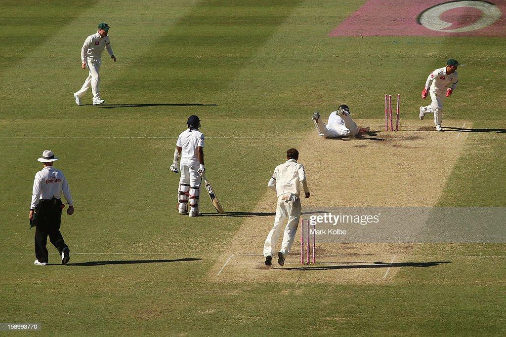 Mahela Jayawardene of Sri Lanka looks on as his partner Angelo Mathews of Sri Lanka is run out by Matthew Wade of Australia during day three of the Third Test match between Australia and Sri Lanka at Sydney Cricket Ground on January 5, 2013 in Sydney, Australia.