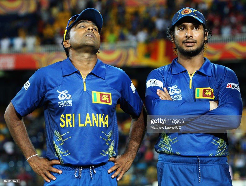 Mahela Jayawardene of Sri Lanka looks on with Kumar Sangakkara after his team lost the ICC World Twenty20 2012 Final between Sri Lanka and West...