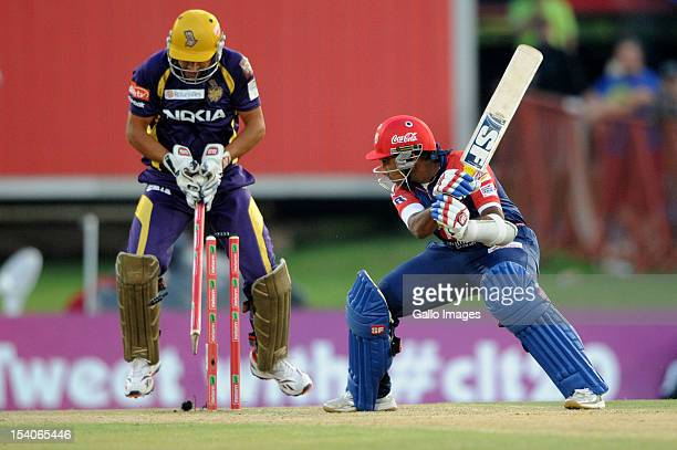 Mahela Jayawardene of the Daredevils is bowled by Sunil Narine as wicketkeeper Manvinder Bisla of the Knight Riders reacts during the Karbonn Smart...