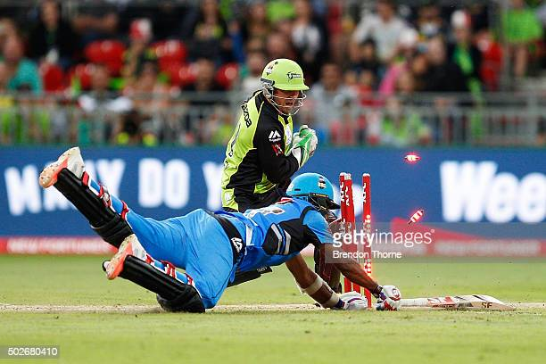 Mahela Jayawardene of the Strikers is run out by Ben Rohrer of the Thunder during the Big Bash League match between the Sydney Thunder and Adelaide...