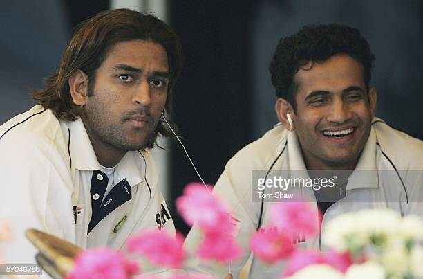 Mahendra Dhoni and Irfan Pathan of India listen to music during day two of the Second Test Match between India and England at the Punjab Cricket...
