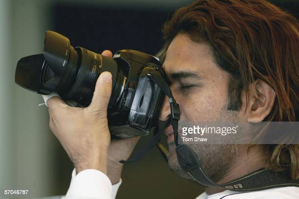 Mahendra Dhoni of India takes photos during day two of the Second Test Match between India and England at the Punjab Cricket Association Ground on...