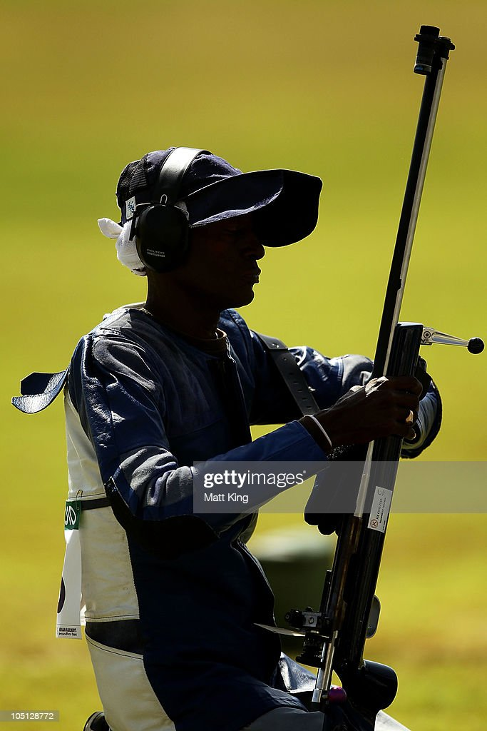Mahendra Persaud of Guyana competes in stage 2 of the 500 yards Pairs Full Bore Open at the CRPF Campus, Kadarpur during day seven of the Delhi 2010 Commonwealth Games on October 10, 2010 in Gurgaon, India.