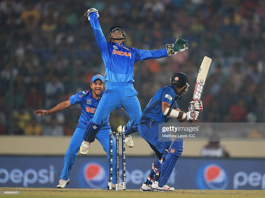 <a gi-track='captionPersonalityLinkClicked' href=/galleries/search?phrase=Mahendra+Singh+Dhoni&family=editorial&specificpeople=539471 ng-click='$event.stopPropagation()'>Mahendra Singh Dhoni</a> of India celebrates catching <a gi-track='captionPersonalityLinkClicked' href=/galleries/search?phrase=Lahiru+Thirimanne&family=editorial&specificpeople=5946377 ng-click='$event.stopPropagation()'>Lahiru Thirimanne</a> of Sri Lanka, off the bowling of Amit Mishra during the ICC World Twenty20 Bangladesh 2014 Final between India and Sri Lanka at Sher-e-Bangla Mirpur Stadium on April 6, 2014 in Dhaka, Bangladesh.