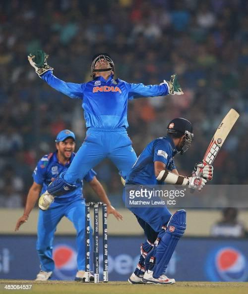 Mahendra Singh Dhoni of India celebrates catching Lahiru Thirimanne of Sri Lanka off the bowling of Amit Mishra during the ICC World Twenty20...