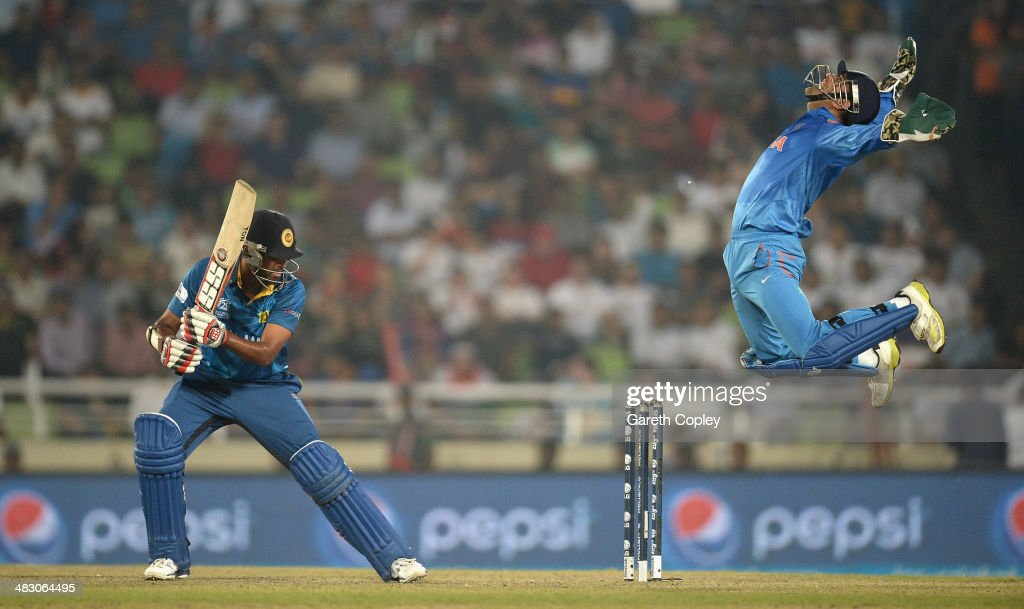 <a gi-track='captionPersonalityLinkClicked' href=/galleries/search?phrase=Mahendra+Singh+Dhoni&family=editorial&specificpeople=539471 ng-click='$event.stopPropagation()'>Mahendra Singh Dhoni</a> of India celebrates catching out <a gi-track='captionPersonalityLinkClicked' href=/galleries/search?phrase=Lahiru+Thirimanne&family=editorial&specificpeople=5946377 ng-click='$event.stopPropagation()'>Lahiru Thirimanne</a> of Sri Lanka during the ICC World Twenty20 Bangladesh 2014 Final between India and Sri Lanka at Sher-e-Bangla Mirpur Stadium on April 6, 2014 in Dhaka, Bangladesh.