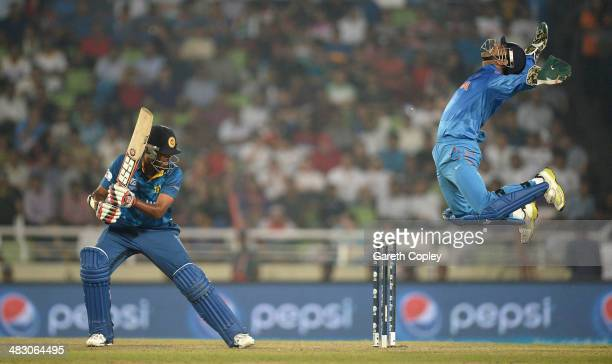 Mahendra Singh Dhoni of India celebrates catching out Lahiru Thirimanne of Sri Lanka during the ICC World Twenty20 Bangladesh 2014 Final between...