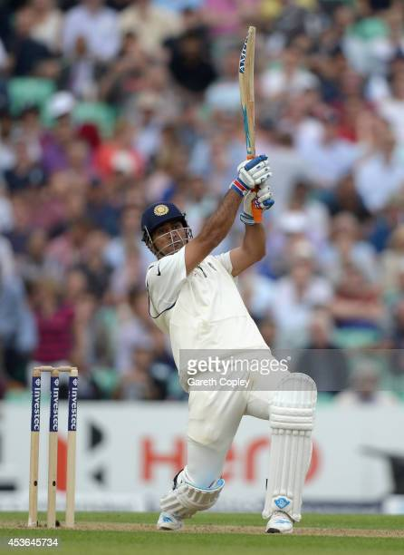 Mahendra Singh Dhoni of India hits out for six runs during day one of 5th Investec Test match between England and India at The Kia Oval on August 15...