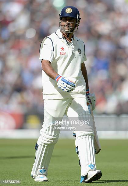 Mahendra Singh Dhoni of India leaves the field after being dismissed by Chris Woakes of England during day three of 5th Investec Test match between...