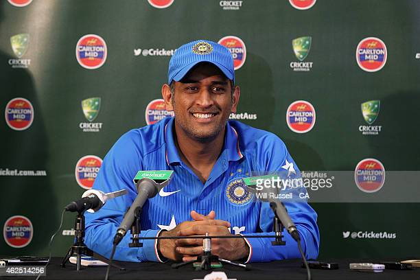 Mahendra Singh Dhoni of India speaks at a press conference after being defeated by England in the One Day International match between England and...
