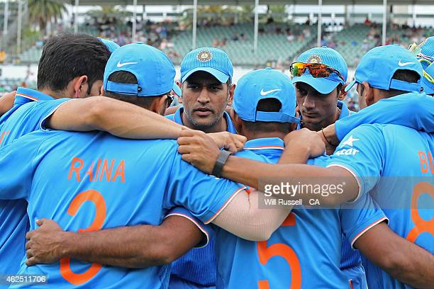 Mahendra Singh Dhoni of India speaks to the team prior to fielding during the One Day International match between England and India at WACA on...