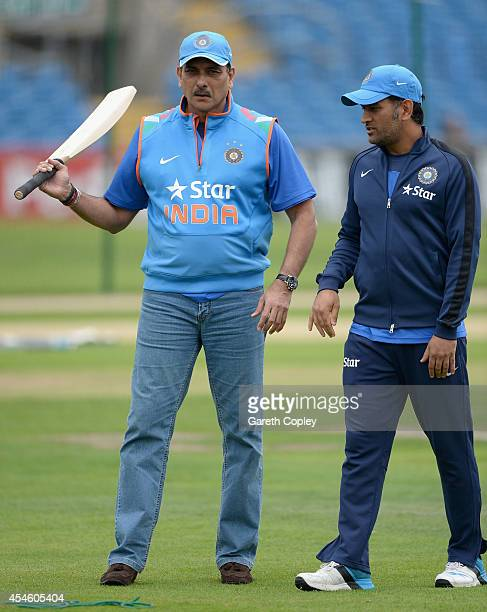 Mahendra Singh Dhoni of India speaks with Director of Cricket Ravi Shastri during a nets session at Headingley on September 4 2014 in Leeds England
