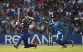 Mahendra Singh Dhoni of India takes a catch for the wicket of Thilan Samaraweera of Sri Lanka only for it to be given not out during the 2011 ICC...
