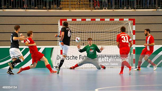 Maher Mazkond of Hamburg challenges Daniel Otto of Schwerte during the DFB Futsal Cup Final between Holzpfosten Schwerte and Hamburg Panthers at...