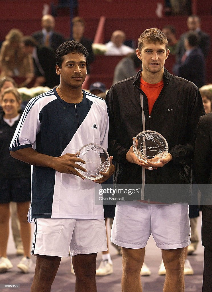 Mahesh Bhupathi and Max Mirnyi with their runners-up trophies after Knowles and Nestors straight sets victory in the final during the Tennis Masters Madrid at The Pabellon De Cristal, Madrid, Spain on October 20, 2002.