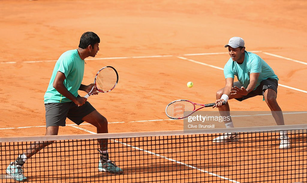 <a gi-track='captionPersonalityLinkClicked' href=/galleries/search?phrase=Mahesh+Bhupathi&family=editorial&specificpeople=171636 ng-click='$event.stopPropagation()'>Mahesh Bhupathi</a> and <a gi-track='captionPersonalityLinkClicked' href=/galleries/search?phrase=Rohan+Bopanna&family=editorial&specificpeople=571696 ng-click='$event.stopPropagation()'>Rohan Bopanna</a> of India in action against Santiago Gonzalez of Mexico and Scott Lipsky of the USA in their doubles semi final match during day seven of the Internazionali BNL d'Italia 2013 at the Foro Italico Tennis Centre on May 18, 2013 in Rome, Italy.