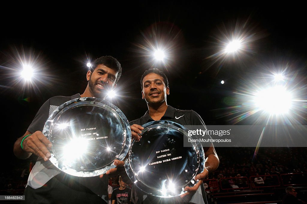 Mahesh Bhupathi (R) and Rohan Bopanna of India pose with their trophy after victory against Aisam Ul Haq Qureshi of Pakistan and Jean Julien Rojer of Netherlands in the Mens Doubles Final on day 7 of the BNP Paribas Masters at Palais Omnisports de Bercy on November 4, 2012 in Paris, France.