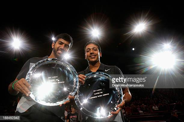 Mahesh Bhupathi and Rohan Bopanna of India pose with their trophy after victory against Aisam Ul Haq Qureshi of Pakistan and Jean Julien Rojer of...