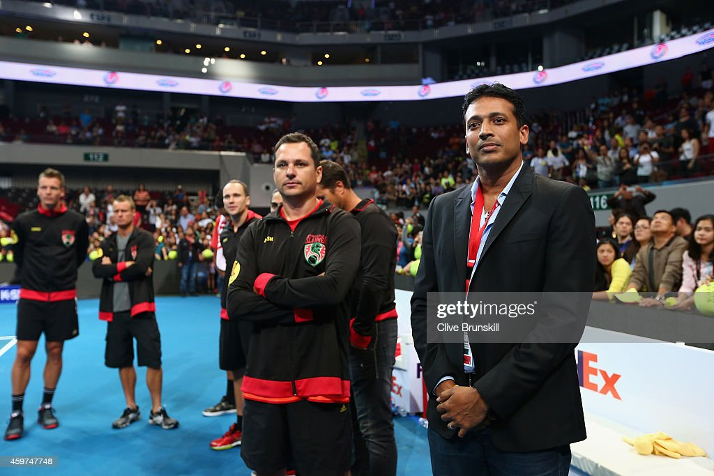 <a gi-track='captionPersonalityLinkClicked' href=/galleries/search?phrase=Mahesh+Bhupathi&family=editorial&specificpeople=171636 ng-click='$event.stopPropagation()'>Mahesh Bhupathi</a> Managing Director of the IPTL stands with Joshua Eagle as he listens to Andy Murray of the Manila Mavericks as he makes a speach to the fans on behalf of all the players after his victory against Nick Krygios of the Singapore Slammers during the Coca-Cola International Premier Tennis League at the Mall of Asia Arena on November 30, 2014 in Manila, Philippines.