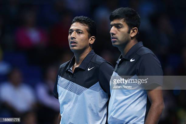 Mahesh Bhupathi of India and Rohan Bopanna of Indialook on during the men's doubles match against Frederik Nielsen of Denmark and Jonathan Marray of...
