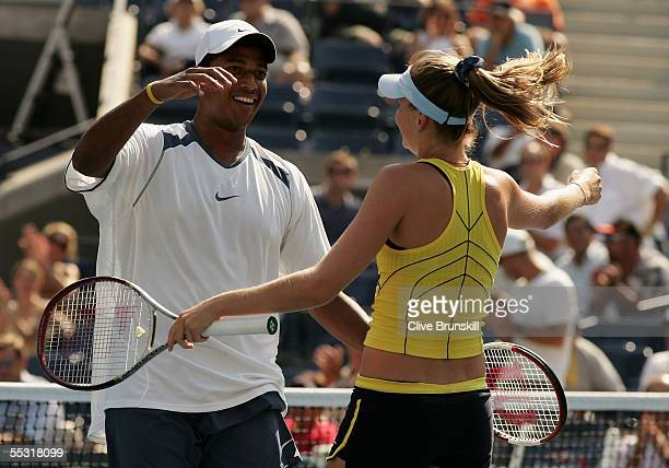 Mahesh Bhupathi of India celebrates with his doubles partner Daniela Hantuchova of Slovakia after winning match point in the mixed doubles final...