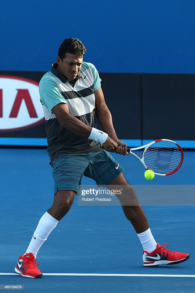 <a gi-track='captionPersonalityLinkClicked' href=/galleries/search?phrase=Mahesh+Bhupathi&family=editorial&specificpeople=171636 ng-click='$event.stopPropagation()'>Mahesh Bhupathi</a> of India plays a backhand in her first round mixed doubles match with Elena Vesnina of Russia against Arantxa Parra Santonja of Spain and David Marrero of Spain during day seven of the 2014 Australian Open at Melbourne Park on January 19, 2014 in Melbourne, Australia.