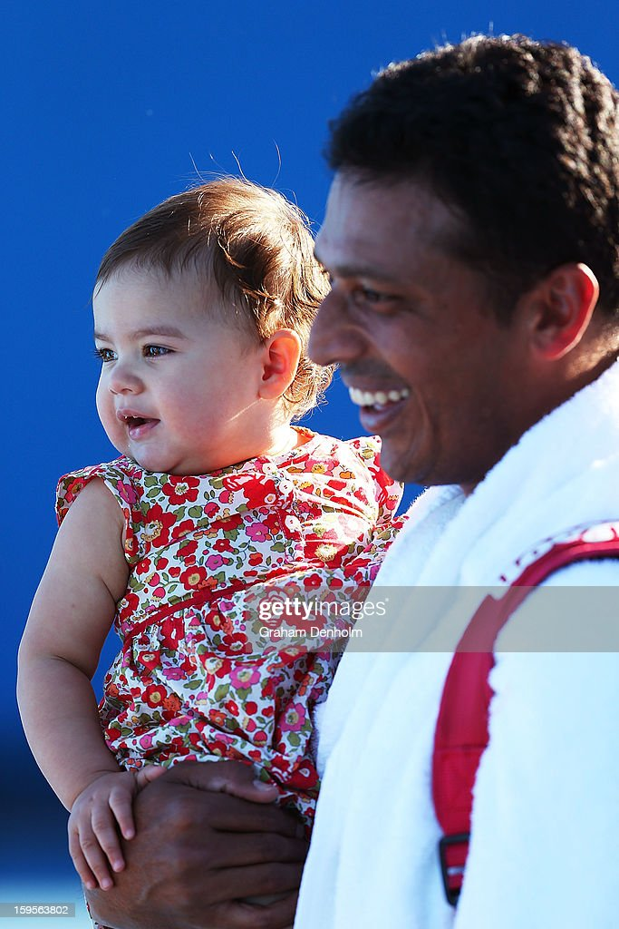 Mahesh Bhupathi of India smiles with his baby following victory in his first round doubles match with Daniel Nestor of Canada against Pablo Andujar of Spain and Guillermo Garcia-Lopez of Spain during day three of the 2013 Australian Open at Melbourne Park on January 16, 2013 in Melbourne, Australia.