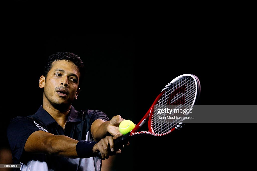 <a gi-track='captionPersonalityLinkClicked' href=/galleries/search?phrase=Mahesh+Bhupathi&family=editorial&specificpeople=171636 ng-click='$event.stopPropagation()'>Mahesh Bhupathi</a> serves with team mate Rohan Bopanna of India in their match against Mariusz Fyrstenberg and Marcin Matkowski of Poland in the Doubles Quarter Final on day 5 of the BNP Paribas Masters at Palais Omnisports de Bercy on November 2, 2012 in Paris, France.
