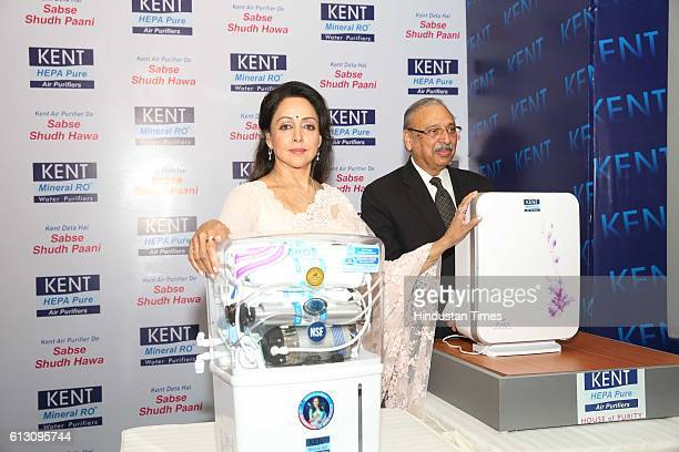 Mahesh Gupta Chairman Kent RO Systems Limited and Bollywood actor and MP Hema Malini during the launch of two models of air purifiers Kent Aura and...