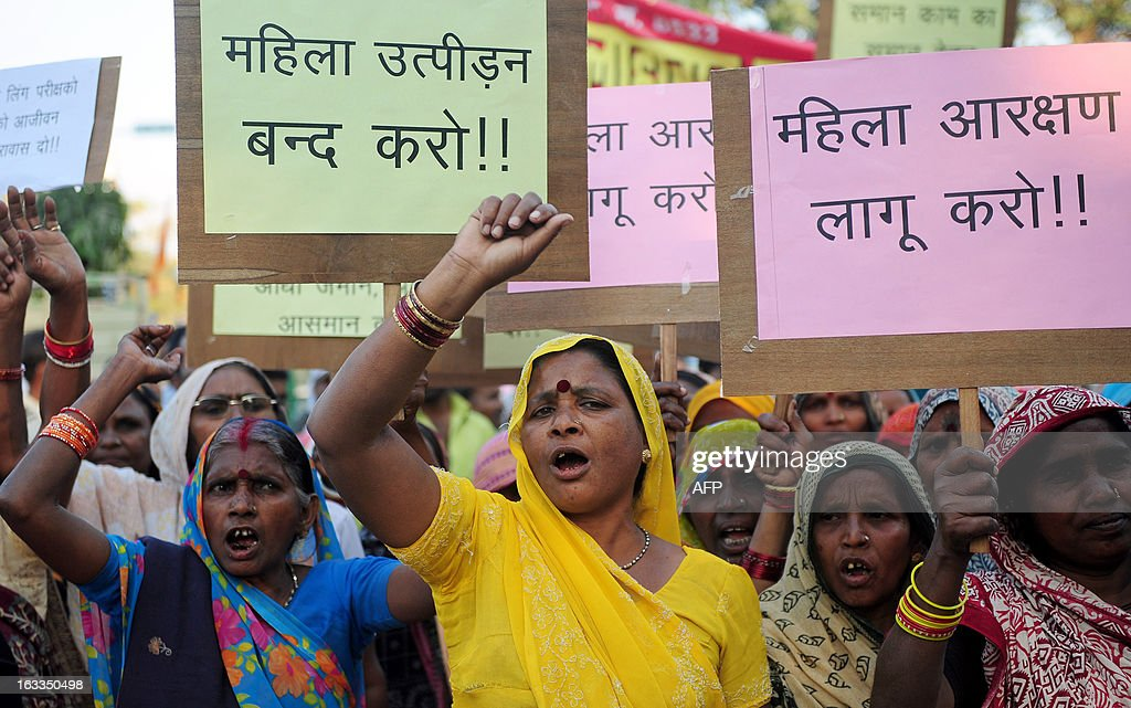 Mahila Adhikar Manch activists shout anti-government slogans during a rally on International World Women's day in Allahabad on March 8, 2013. The demonstrators were demanding the passing of the bill which will reserve 33 per cent of all seats in the Lower house of Parliament and in all state legislative assemblies to women. AFP PHOTO/ SANJAY KANOJIA
