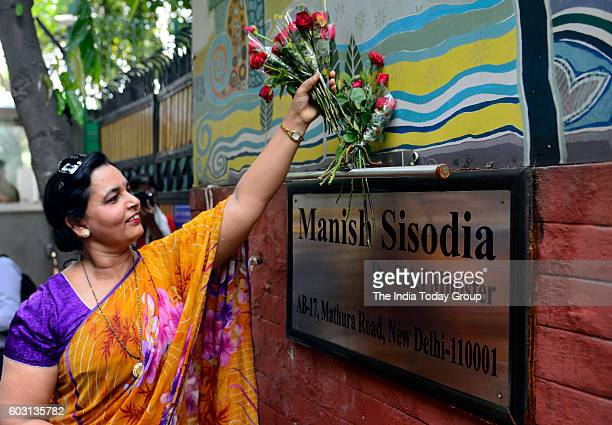Mahila Morcha worker placing roses at Delhi Deputy Chief Minister Manish Sisodia's residence during a protest against sacked minister Sandeep Kumar...