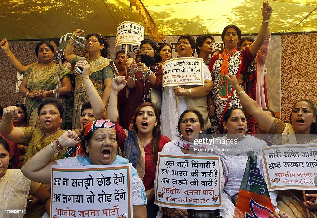 BJP Mahila Morcha workers during the dharna protest against the Police Commissioner and Delhi CM Sheila Dikshit at Jantar Mantar on September 6, 2013 in New Delhi, India. BJP demanding resignation of Chief Minister Sheila Dikshit in the wake of a Delhi court ordering registration of FIR against her and others for allegedly misusing government funds for a 2008 pre-assembly poll advertisement campaign.