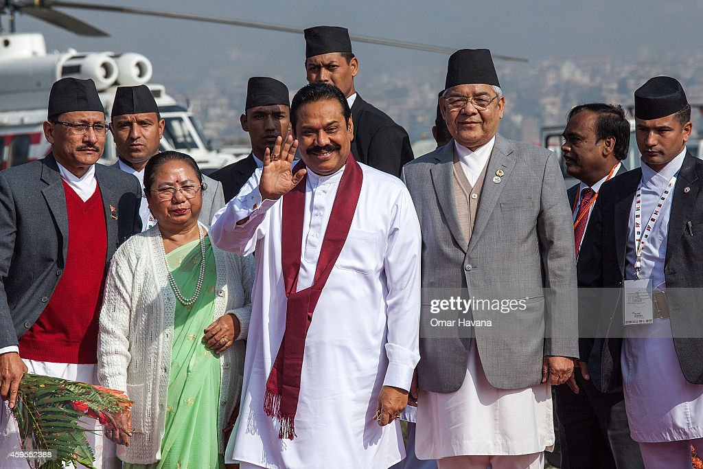<a gi-track='captionPersonalityLinkClicked' href=/galleries/search?phrase=Mahinda+Rajapaksa&family=editorial&specificpeople=588377 ng-click='$event.stopPropagation()'>Mahinda Rajapaksa</a>, President of Sri Lanka (C) is greeted by the Deputy Prime Minister of Nepal Bam Dev Gautam during his arrival in Tribhuvan International Airport for the 18th SAARC Summit on November 25, 2014 in Kathmandu, Nepal. On 26-27 November, Nepal will be hosting the 18th South Asian Association for Regional Cooperation (SAARC) Summit in Kathmandu, which will be attended by leaders of Nepal, Afghanistan, Bangladesh, Pakistan, India, the Maldives, Sri Lanka and Bhutan. Nepal is hosting the SAARC Summit for the third time, which was first held in Dhaka, Bangladesh in 1985. Some of the main issues to be discussed during the summit will include three key framework agreements between SAARC countries to enhance rail and road connectivity and to set up a regional power grid.