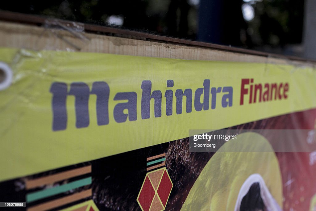 Mahindra & Mahindra Financial Services Ltd. signage is displayed outside one of the company's branches in Mumbai, India, on Tuesday, Dec. 18, 2012. Among the largest non-bank financial institutions are Mahindra & Mahindra Financial Services Ltd. and Muthoot Capital Services Ltd., a publicly traded company controlled by the same family that runs Muthoot Fincorp and which also makes loans for gold. Photographer: Dhiraj Singh/Bloomberg via Getty Images