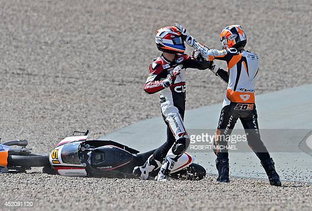 Mahindra rider Bryan Schouten of Netherlands and his compatriot Kalex KTM rider Scott Derouse fight after crashing in the Moto3 race of the Grand...