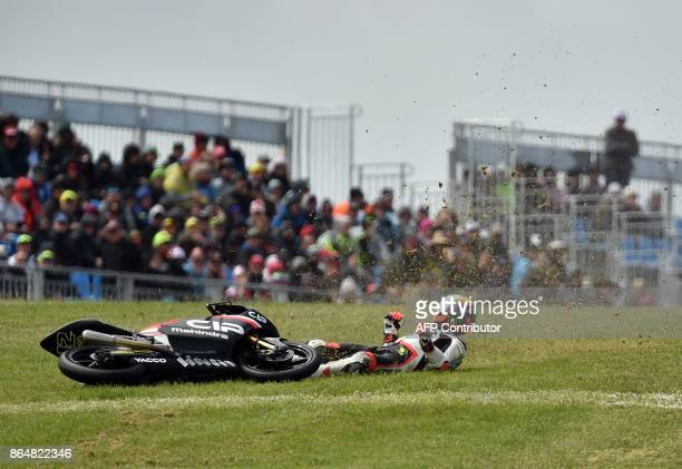 Mahindra rider Marco Bezzecchi of Italy crashes during the Moto3class Grand Prix of the Australian MotoGP Grand Prix at Phillip Island on October 22...