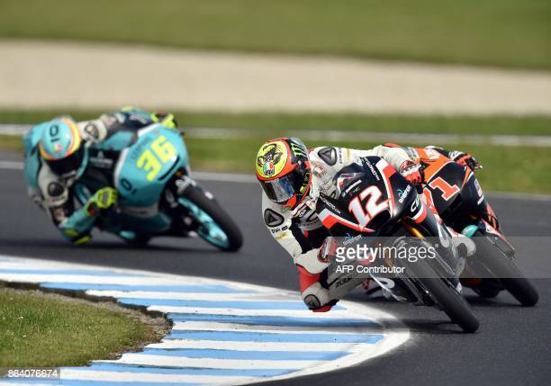 Mahindra rider Marco Bezzecchi of Italy leads Honda rider Ayumu Sasaki of Japan and Honda rider Joan Mir of Spain during the Moto3class third...