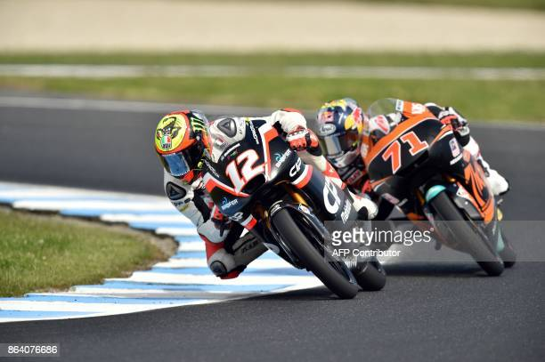 Mahindra rider Marco Bezzecchi of Italy leads Honda rider Ayumu Sasaki of Japan during the Moto3class third practice session of the Australian MotoGP...