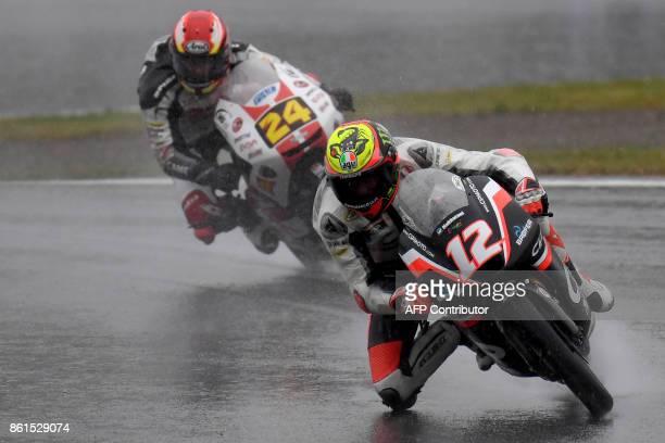 Mahindra rider Marco Bezzecchi of Italy leads Honda rider Tatsuki Suzuki of Japan during the Moto3 class of the MotoGP Japanese Grand Prix at Twin...